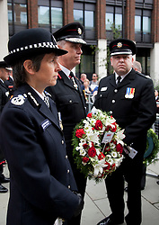 © Licensed to London News Pictures. 11/09/2011. London, UK. Assistant Commissioner Cressida Dick attended the ceremony. The London Fire Brigade and the Firefighters' Memorial Trust marked the tenth anniversary of the September 11th terror attacks with a wreath-laying ceremony at the Firefighters' National Memorial in Peter's Hill near St. Paul's Cathedral. This event also marked the 20th anniversary of the Firefighters' Memorial Trust. Photo credit: Bettina Strenske/LNP