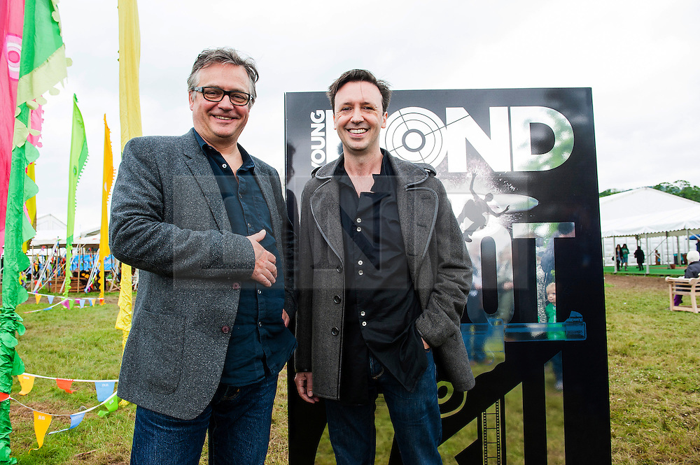 © Licensed to London News Pictures. 28/05/2014. Hay-on-Wye, UK. Charlie Higson (L), author of the first five Young Bond adventures, officially hands over the franchise to Steve Cole, The cover and title of Steve Cole's first Young Bond novel is revealed today Wednesday, May 28 (Ian Fleming's birthday), at a special Young Bond event at the Hay Festival of Literature & the Arts. Photo credit : Graham M. Lawrence/LNP