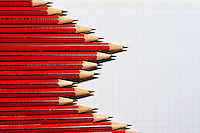 Pencils forming bar graph pattern on graph paper view from above
