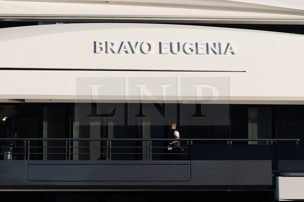 © Licensed to London News Pictures. 04/12/2019. London, UK. A man onboard Dallas Cowboys owner and billionnaire, Jerry Jones's luxury 358 feet (109 meters) superyacht, Bravo Eugenia which is seen moored at Butlers Wharf, near Tower Bridge on the River Thames after arriving in the capital late yesterday afternoon. The $225 million yacht which was built in 2018 is reported to be named after Jerry Jones's wife, Eugenia and have multiple luxuries onboard including two helipads, a fitness centre and sauna, and is capable of sleeping up to 14 people who are taken care of by a 30-person crew. Photo credit: Vickie Flores/LNP