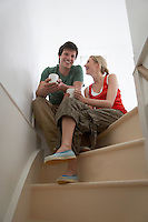 Couple sitting on stairs smiling