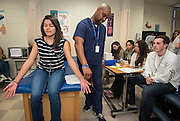 Students learn about the diagnosis of nerve disorders at Westside High School, January 30, 2014.