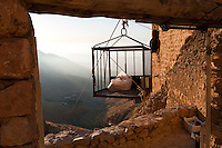 A plastic bag of fresh flat bread, brought up by rope from the valley below at sunrise, to Deir Mar Musa, a monastery established in the 6th century in Syria