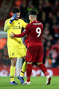 Congratulations - Liverpool goalkeeper Alisson Becker (13) and hat trick hero Liverpool striker Roberto Firmino (9) during the Premier League match between Liverpool and Arsenal at Anfield, Liverpool, England on 29 December 2018.