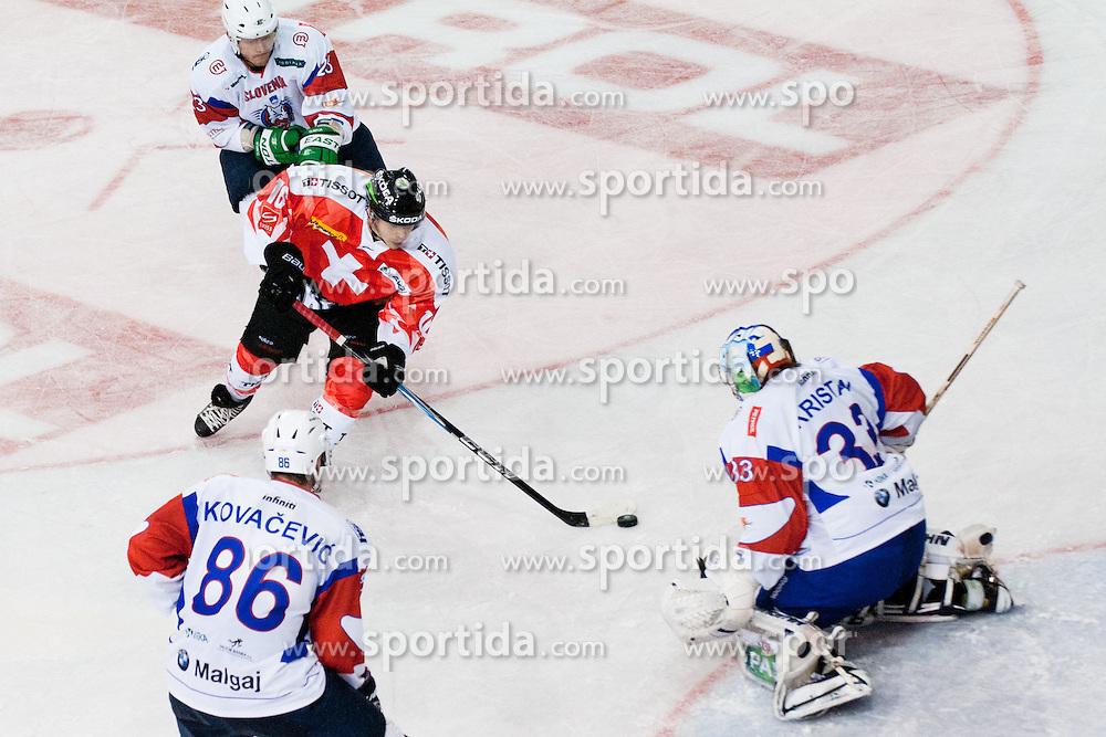 Inti Pestoni of Switzerland vs Robert Kristan of Slovenia during friendly ice-hockey match between Slovenia and Switzerland, on December 14, 2011 at Hala Tivoli, Ljubljana, Slovenia. (Photo By Matic Klansek Velej / Sportida)