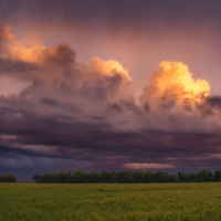 Weakening storm at sunset over the agricultural fields of central Kansas.
