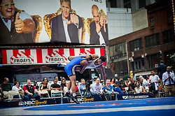 Jun 07, 2012 : Nasim Banks (winner, in gold) and Nigel Williams (blue) compete in a youth exhibition wrestling match in Times Square as part of the Beat The Streets 2012 Gala and Benefit. Beat The Streets is a New York City-based not-for-profit organization that has brought wrestling to thousands of middle and high school students in the city. Credit:  Rob Bennett for The Wall Street Journal Slug: TSWrestle