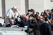 Pope Francis greets the faithful upon his arrival in St. Peter's square at the Vatican for his weekly general audience on March 14, 2018
