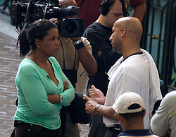 04 Sept  2005. New Orleans, Louisiana. Post hurricane Katrina.<br /> Oprah Winfrey, US talk show host, visits the Hyatt Hotel in New Orleans as she prepares to survey the hurricane damage. Oprah interviews Mayor Ray Nagin in an emotional piece.<br /> Photo Credit ©: Charlie Varley/varleypix.com