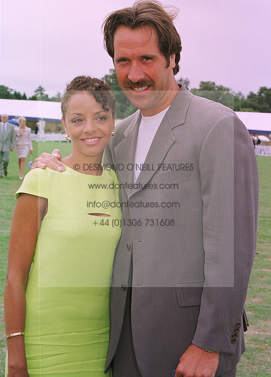 MR & MRS DAVID SEAMAN the England footballer, at a polo match in Berkshire on 26th July 1998.MJG 56