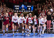Nebraska's bench erupts after defeating Penn State in five sets in their NCAA semifinal volleyball match at the Devaney Center on Friday, Dec. 9, 2016, in Lincoln. Nebraska defeated Penn State 23-25, 23-25, 26-24, 25-19, 15-6.<br /> <br /> MATT DIXON/THE WORLD-HERALD