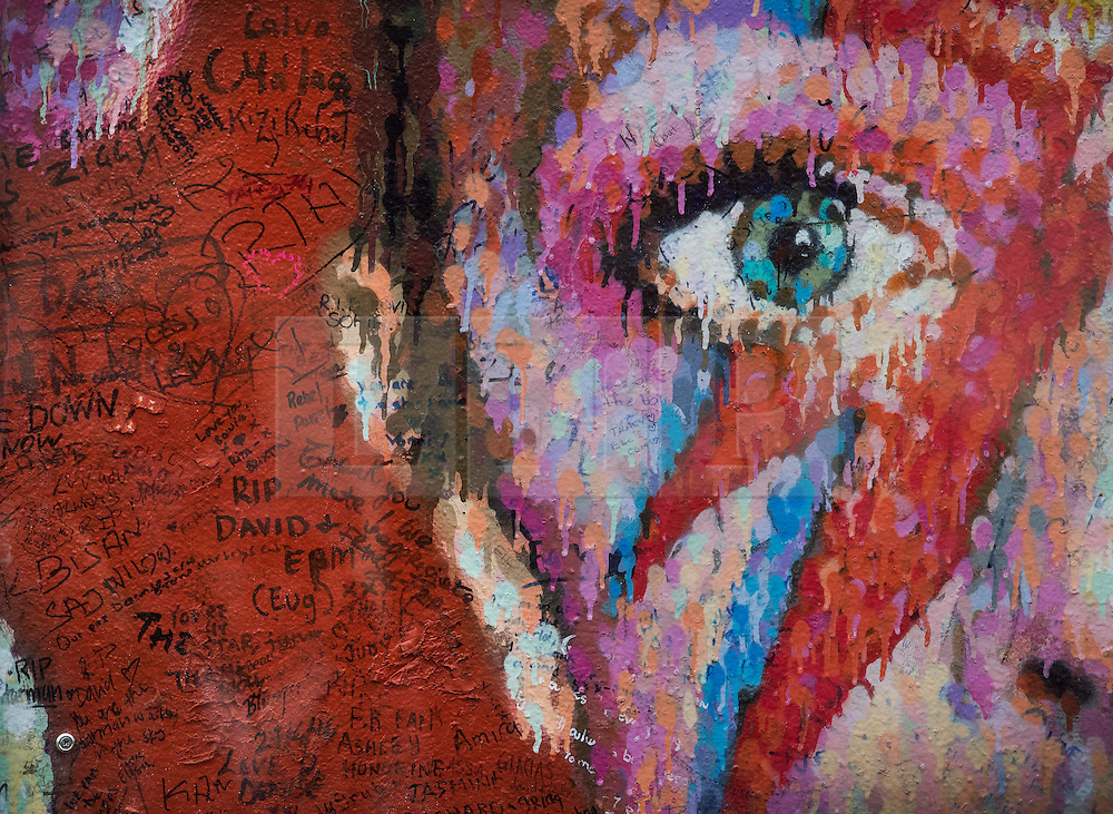 © Licensed to London News Pictures. 10/01/2017. London, UK. Written messages surround a mural and shrine to David Bowie in Brixton on the first anniversary of his death. David Bowie was born in Brixton, south London. Photo credit: Peter Macdiarmid/LNP