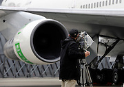 A members of the media films the engine of a Japan Airlines Corp. 747 passenger plane during an engine test prior to a demonstration flight that utilized sustainable fuel in one engine in Tokyo, Japan.