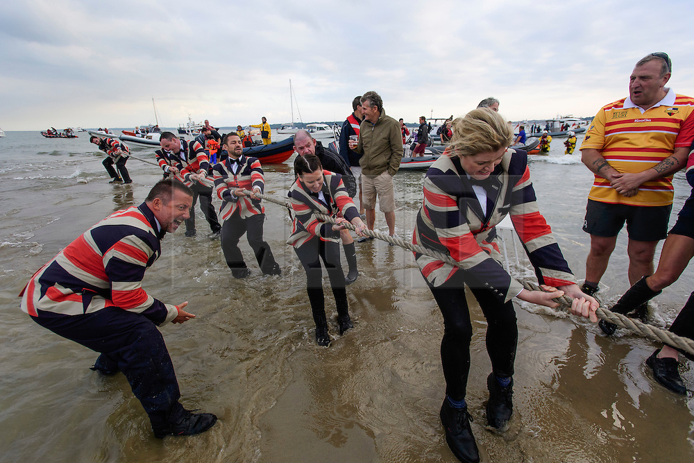 © Licensed to London News Pictures. 18/09/2016. Portsmouth, UK. A tug of war match before the cricket. Teams take part in the  Bramble Bank Cricket Match in the middle of The Solent strait on September 18, 2016. The annual cricket match between the Royal Southern Yacht Club and The Island Sailing Club, takes place on a sandbank which appears for 30 minutes at lowest tide. The game lasts until the tide returns. Photo credit: Ben Cawthra/LNP