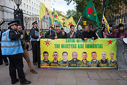 London, UK. 9 October, 2019. Kurdish supporters of the YPG protest opposite Downing Street against the ground invasion by Turkey of Kurdish-held areas of northern Syria following attacks on Kurdish-led forces there by Turkish warplanes and artillery.
