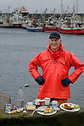 Karel Karelsson, a commercial cod fisherman, with his typical day's worth of food at his home port of Sandgerdi on the western side of Reykjanes peninsula, Iceland. (From the book What I Eat: Around the World in 80 Diets.) MODEL RELEASED.