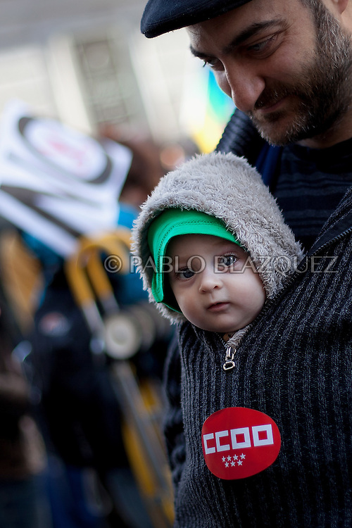 An infant and his father attend a protest against the economic policies of the Spanish government during May Day in Madrid on May 1, 2012. Trade Unions CCOO and UGT have called for continues demonstrations against the severe austerity plans of the Spanish government. This month unemployment has reached a record rate and the government has announced that immigrants with no legal status will not be covered by the health public services. The government aims to get the deficit down to 5.3 percent this year and 3.0 percent in 2013.
