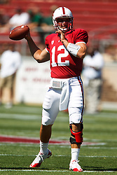 September 4, 2010; Stanford, CA, USA;  Stanford Cardinal quarterback Andrew Luck (12) throws a pass before the game against the Sacramento State Hornets at Stanford Stadium.  Stanford defeated Sacramento State 52-17.