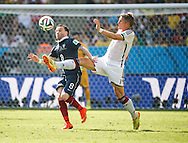 Mathieu Valbuena of France (L) is challenged by Bastian Schweinsteiger of Germany (R) during the 2014 FIFA World Cup match between France and Germany at the Maracana Stadium, Rio de Janeiro<br /> Picture by Andrew Tobin/Focus Images Ltd +44 7710 761829<br /> 04/07/2014