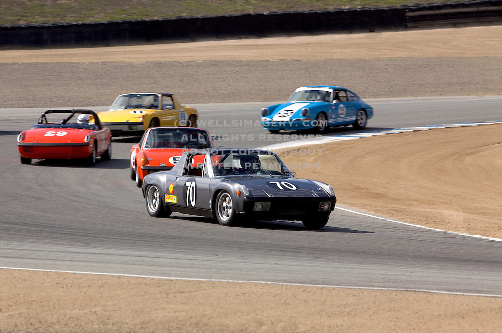 Image of porsches racing at Rennsport Reunion IV, Laguna Seca, California, America west coast