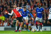 Orkun Kokcu (#23) of Feyenoord Rotterdam tackles Ryan Jack (#8) of Rangers FC during the Europa League match between Rangers FC and Feyenoord Rotterdam at Ibrox Stadium, Glasgow, Scotland on 19 September 2019.