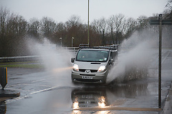 © Licensed to London News Pictures. 26/01/2014. M3, Basingstoke, Hampshire, UK. A van driving through flood water in Basingstoke today (26/01/2014). Wet and windy weather has engulfed much of the UK over the weekend. Photo credit : Rob Arnold/LNP