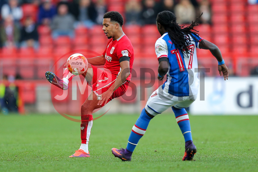 Korey Smith of Bristol City is challenged by Marvin Emnes of Blackburn Rovers - Rogan Thomson/JMP - 22/10/2016 - FOOTBALL - Ashton Gate Stadium - Bristol, England - Bristol City v Blackburn Rovers - Sky Bet EFL Championship.