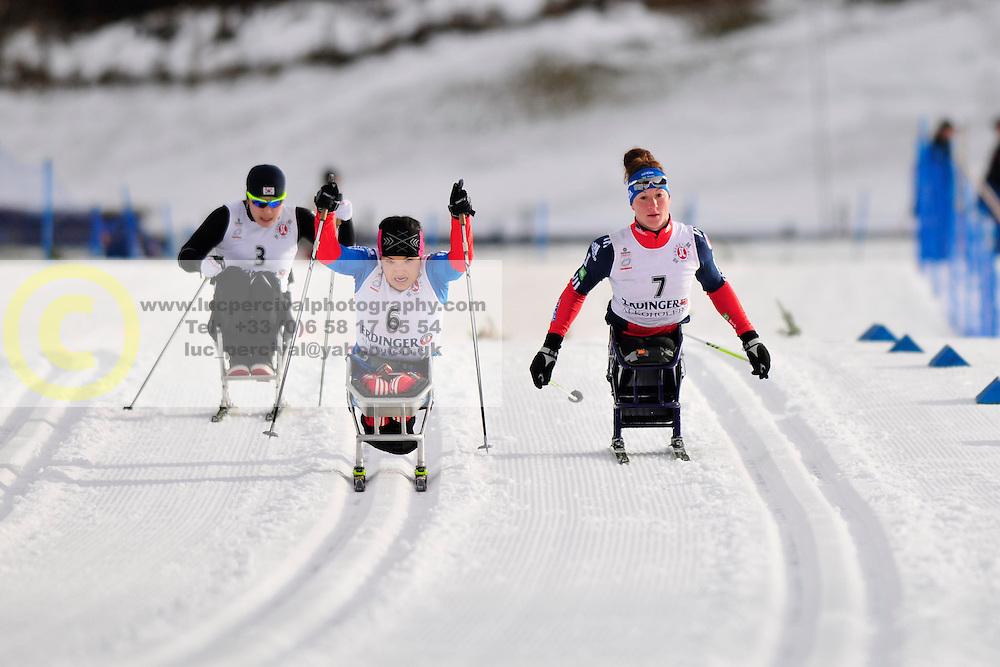 SEO Vo-Ra-Mi, KOR, ABDIKARIMOVA Akzhana, RUS, McFADDEN Tatyana, USA at the 2014 IPC Nordic Skiing World Cup Finals - Middle Distance