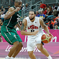 02 August 2012: USA Deron Williams drives past Nigeria Derrick Obasohan during 156-73 Team USA victory over Team Nigeria, during the men's basketball preliminary, at the Basketball Arena, in London, Great Britain.