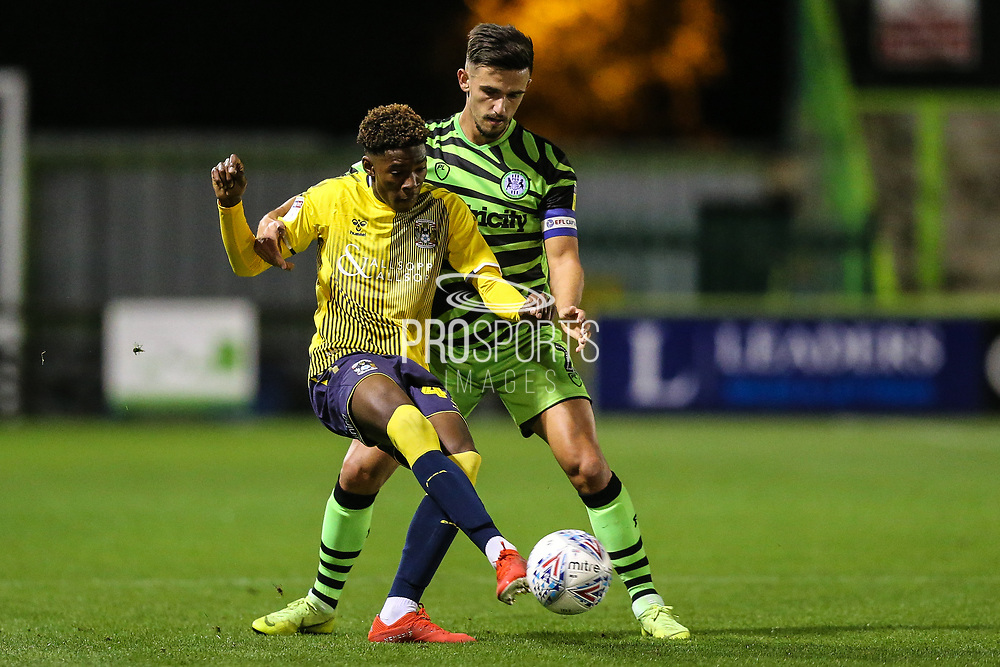 Coventry City's Will Bapaga(41) holds off Forest Green Rovers Liam Shephard(2) during the Leasing.com EFL Trophy match between Forest Green Rovers and Coventry City at the New Lawn, Forest Green, United Kingdom on 8 October 2019.