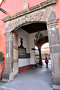 Stone entrance to the historic Hacienda Galindo, a 16th century estate once owned by the Spanish Conquistador Hernando Cortes, in San Juan del Rio, Queretaro, Mexico. The hacienda is now a hotel and resort owned and operated by Fiesta Americana.