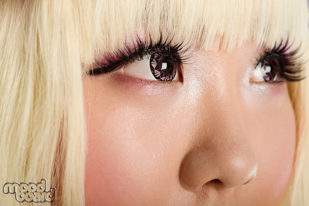 Extreme close-up of cute young woman's face with blond hair