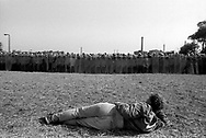 Picket laying down in front of police with riot shields at Orgreave. 18 June 1984