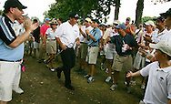 Golfer Phil Mickelson (C), of the United States, is cheered by spectartors after hitting his ball back on to the fairway during the first round of the 2005 PGA Championship at Baltusrol Golf Club in Springfield, New Jersey, Thursday 11 August 2005. Mickelson was 2 strokes under par after 16 holes.