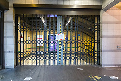 © Licensed to London News Pictures. 19/03/2020. London, UK. Barbican tube station near St Bartholomew's Hospital in London is seen closed this morning. Transport for London (TfL) are closing a number of underground stations from today, as partial closure of the tube and rail network begins in response to the growing coronavirus outbreak in the captial. Photo credit: Vickie Flores/LNP