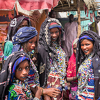Bororo girls at the market in Bosso near the border with Nigeria. The conflict and the resulting lack of security have caused the local economy to crash and severely hampered cross-border trade, fishing, irrigated agriculture and nomadic herding. In an area where climatic conditions are already precarious and options limited, people are turning increasingly to aid. In Bosso alone, the ICRC is providing almost 25,000 people – nearly a third of the population – with emergency food aid every month.