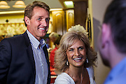 28 AUGUST 2012 - MESA, AZ:  Congressman JEFF FLAKE and his wife, CHERYL FLAKE, talk to supporters in their Mesa, AZ, home on election night. Flake is the incumbent Congressman from Arizona's 6th Congressional District. He won the Republican primary for the US Senate seat being vacated by retiring Senator Jon Kyl. Flake faced Arizona businessman and political newcomers Wil Cardon in the primary and won handily.    PHOTO BY JACK KURTZ