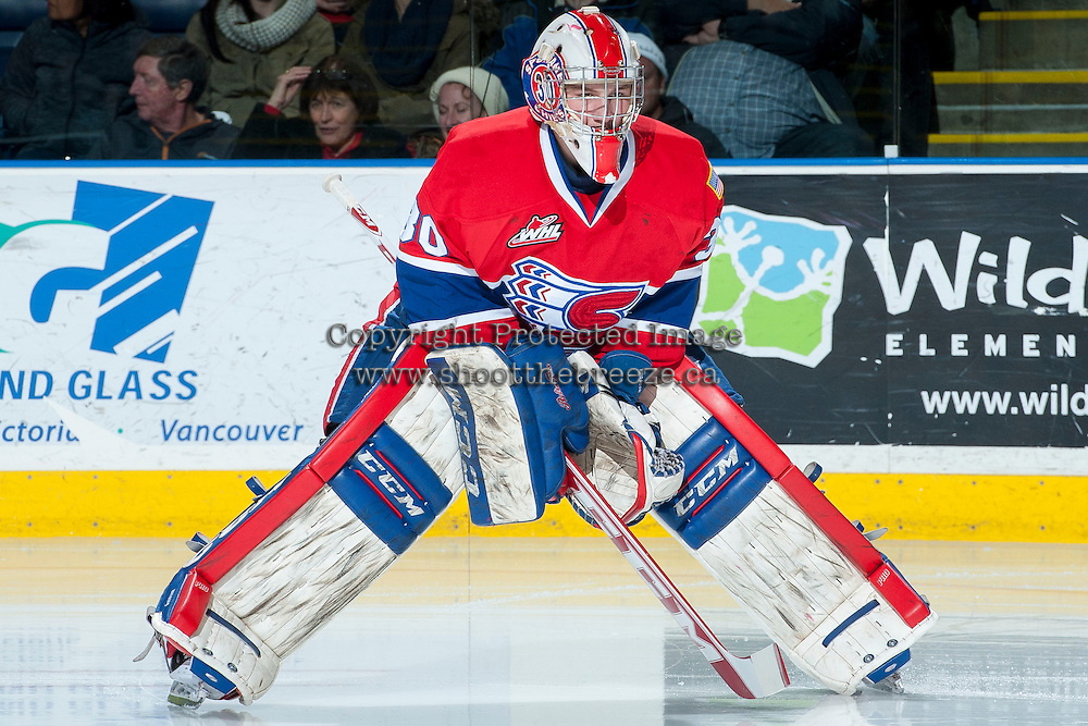 KELOWNA, CANADA -JANUARY 29: Garret Hughson G #30 of the Spokane Chiefs stands on the ice after a goalie change by the Spokane Chiefs against the Kelowna Rockets on January 29, 2014 at Prospera Place in Kelowna, British Columbia, Canada.   (Photo by Marissa Baecker/Getty Images)  *** Local Caption *** Garret Hughson;