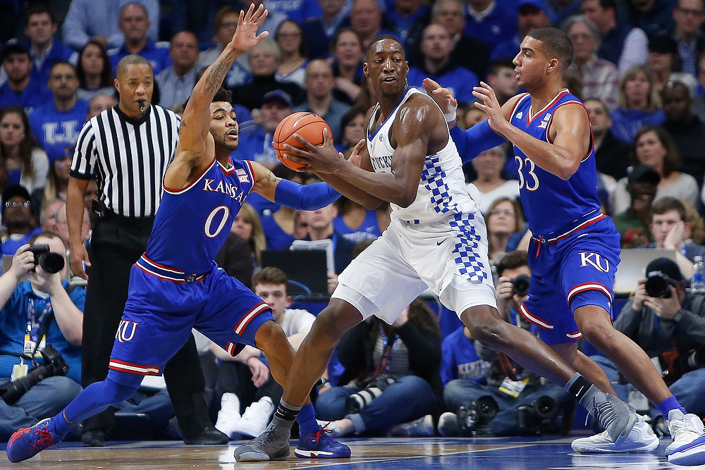 Kentucky Wildcats forward Bam Adebayo is defended by guard Frank Mason III and Kansas Jayhawks forward Landen Lucas on Saturday January 28, 2017 at Rupp Arena in Lexington, Ky. Photo by Michael Reaves | Staff