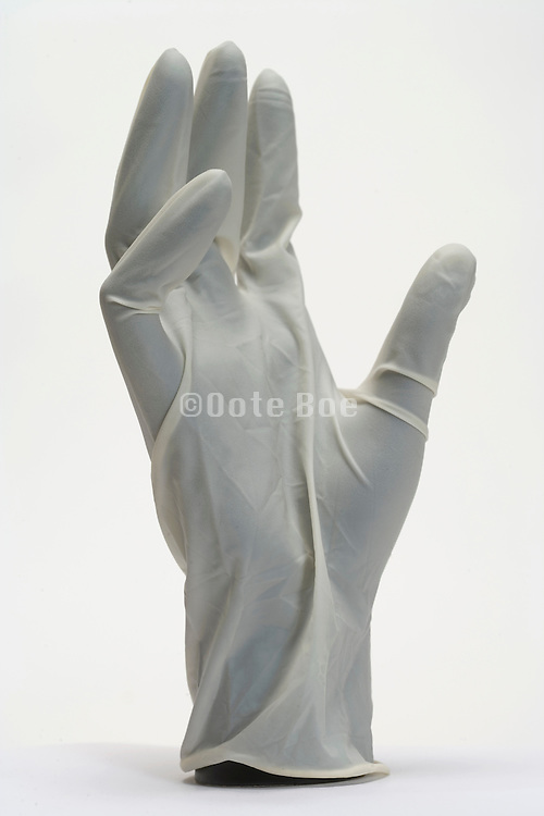 a mannequin's hand with a latex multi purpose glove on