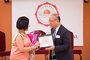 Milpitas Mayor Jose Esteves presents Ritu Marwah of Art of Living Foundation with a Commendation certificate during the World Culture Festival Bay Area Curtain Raiser event at the India Community Center in Milpitas, California, on January 20, 2016. (Stan Olszewski/SOSKIphoto)
