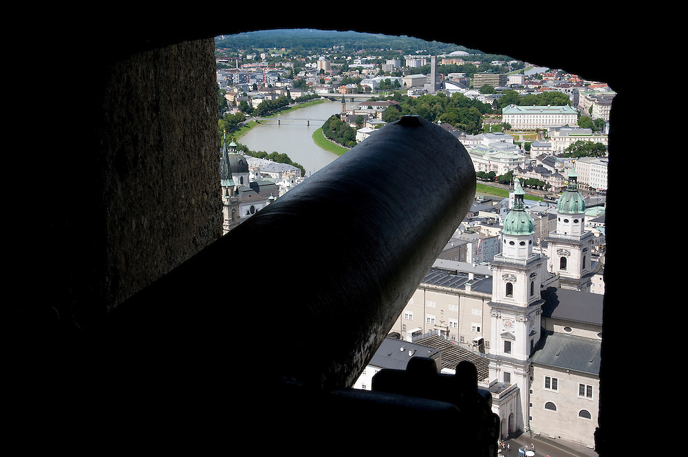 As with most castles in Europe, the Hohensalzburg Fortress evolved over time.  Begun in 1077 as a bailey, the towers and ring wall were completed by 1462.  With the advent of cannon, artillery emplacements were added.  Here a cannon overlooks Old Town Salzburg.