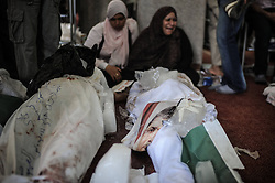 60360669  <br /> An Egyptian woman cries beside a dead body at a mosque where lines of bodies wrapped in shrouds were laid out in Cairo, Egypt, August 15, 2013. At least 525 were killed and 3,717 others injured across Egypt in clashes between supporters of ousted President Mohamed Morsi and the security troops, after the latter dispersed Wednesday two major pro-Morsi sit-ins in Cairo and Giza, a Health Ministry official said Thursday, August 15, 2013. <br /> Picture by imago / i-Images<br /> UK ONLY