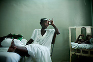Marie Luisa Badio, 44, waits at University Hospital in Port-au-Prince, Haiti for a set of promised operations for a tumor in her gastric system on March 1, 2010. The hospital's Department of Internal Medicine was one of the few buildings not damaged in the January 12 quake and although the wing is still open to patients, the NGO resources supporting the rest of the hospital—housed in outdoor tents – are not available here. (photo by Allison Shelley)