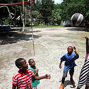 "Trevionne Blue, 9, from left, Lagarrick Donaldson, 5, Tayshaun Donaldson, 7, and Zyasia Aiken, 7, play a ball game of ""21""on Thursday afternoon in a grass lot near their homes north of the Marine Corps Air Station Beaufort off of Bruce K. Smalls Drive."