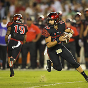 08 October 2016: The San Diego State Aztecs football team open's up the mountain west conference season at home against the University of Nevada Las Vegas Lobos. San Diego State quarterback Christian Chapman (10) drops back to pass in the first quarter. The Aztecs lead the Lobos 13-7 at halftime. www.sdsuaztecphotos.com
