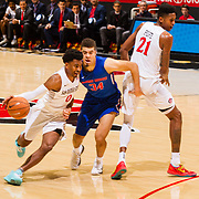 27 February 2018: San Diego State men's basketball hosts Boise State in it's last meet up of the regular season at Viejas Arena. San Diego State Aztecs guard Devin Watson (0) drives the ball around a screen set by teammate Malik Pope (21). The Aztecs lead 38-37 at halftime. <br /> More game action at sdsuaztecphotos.com