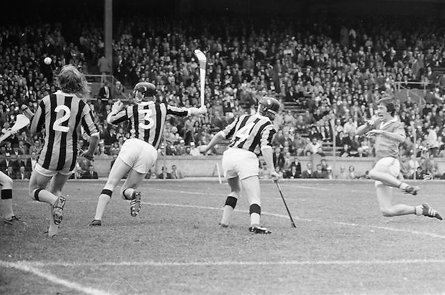 Players fill the Tipperary goalmouth as the slitor is hit out by the goalie during the All Ireland Minor Hurling Final, Tipperary v Kilkenny in Croke Park on the 5th September 1976.
