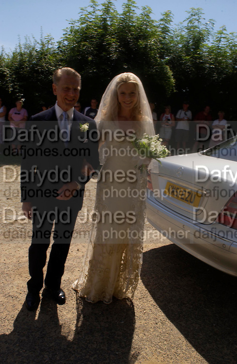 Edward Fox with the Bride. Marriage of Emilia Fox to Jared Harris. St. Michael's and All Angels. Steeple. Nr. Wareham. Dorset. 16 July 2005. ONE TIME USE ONLY - DO NOT ARCHIVE  © Copyright Photograph by Dafydd Jones 66 Stockwell Park Rd. London SW9 0DA Tel 020 7733 0108 www.dafjones.com