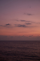 Pastel colored sky and clouds over the Pacific Ocean at dawn.  Image 3 of 21  for a panorama taken with a Fuji X-T1 camera and 35 mm f/1.4 lens  (ISO 400, 35 mm, f/2.8, 1/30 sec). Raw images processed with Capture One Pro and stitched together with AutoPano Giga Pro.